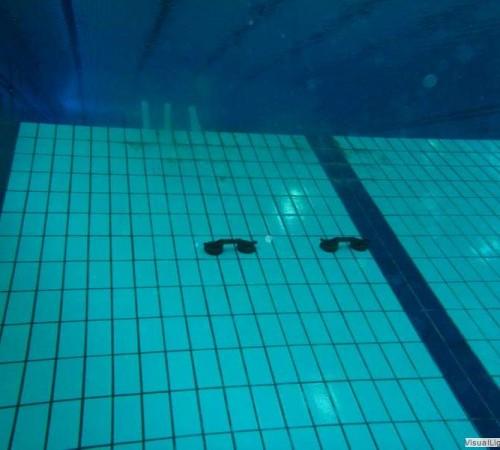 Tegelreparatie schuine wand duiklkuil Orka zwembadreparatie